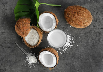 Composition with fresh coconut water on dark background