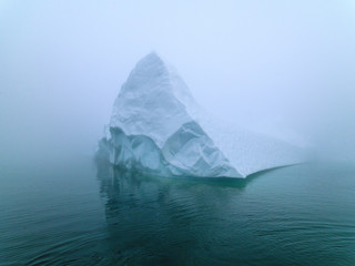 Icebergs in foggy day on Arctic Ocean in Greenland