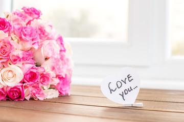 Rose flowers and inscription I love you. The concept of Valentine's Day, holiday greetings, love, 8 March.