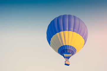 Colorful of hot air balloon on blue sky background. Toned