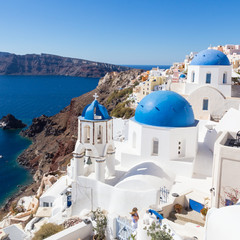 Spoed Foto op Canvas Santorini Cityscape of Oia, traditional greek village with blue domes of churches, Santorini island, Greece.