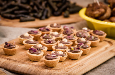 Chocolate Puddings Within Sweet Cookie Bowls on a Wooden Tray