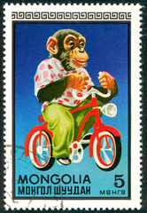 Ukraine - circa 2017: A postage stamp printed in Mongolia shows drawing Monkey on bike. Series: Circus.. Circa 1973.