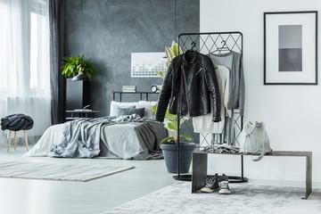 Multifunctional grey bedroom with jacket