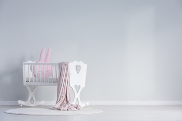 White baby's bedroom with cradle