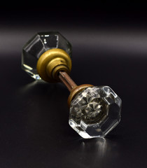 Antique Doorknobs Arranged on a Seamless Black Background