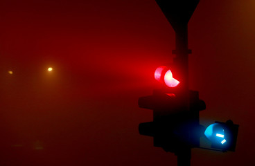 Traffic lights are seen as evening fog and air pollution covers Skopje