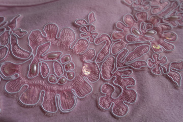 Embroidered pink fabric with sequins and pearls