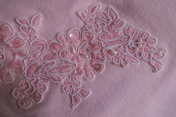 Paillettes, pearl beads and embroidery on pink fabric