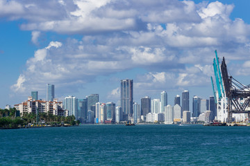 USA, Florida, Miami City Skyline with harbour cranes from sout pointe pier park