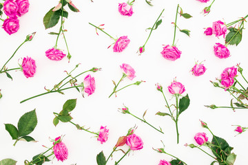Floral pattern with pink roses, branches and leaves on white background. Flat lay, Top view. Roses texture