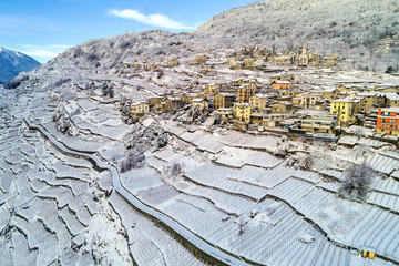 Valtellina (IT) - Vista aerea panoramica invernale di Sant'Anna a Sondrio
