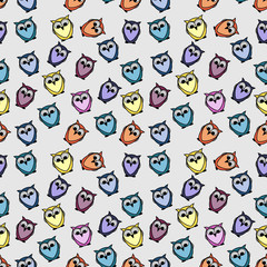 Seamless pattern with colorful owls birds, cartoon owls background