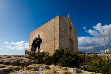 Couple above high Dingli cliffs