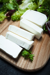 Natural feta cheese from cow's milk sliced with slices.