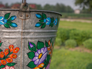 A bucket over a well in the colorful village, Zalipie
