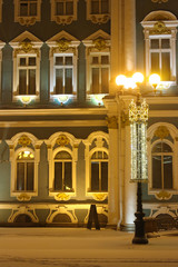 St. Petersburg, the Winter Palace windows are lit by a lantern decorated for the Christmas holiday on a winter night.