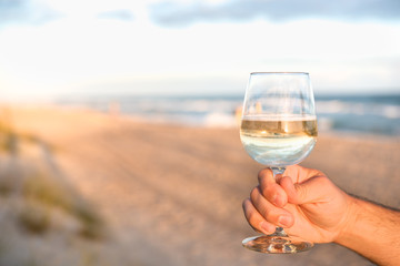 Offering wine on the beach