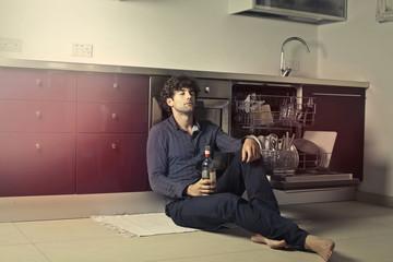 Man drinking in the kitchen