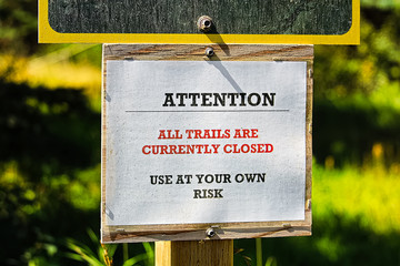 Attention all trails are currently closed sign