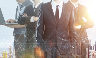 Business partner team standing together , double exposure effect with cityscape and stock statistics graph .