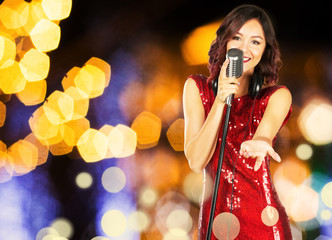 Beautiful and stylish woman singerwith a microphone