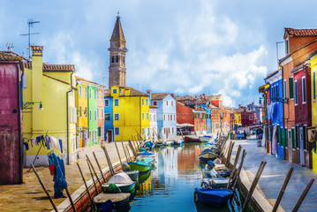Wall Mural - Colorful houses, canal, boat and church on the famous island Burano island, Venice, Italy