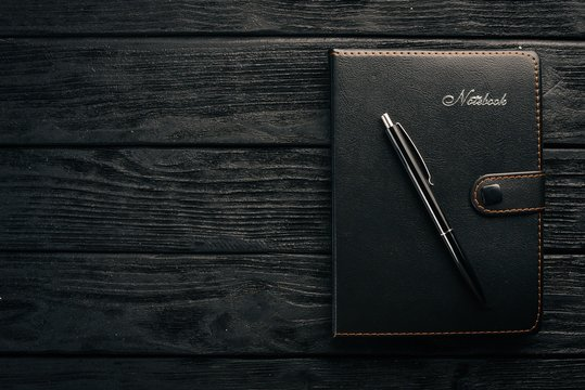 Notebook. Office desktop. Top view. Free space for text.