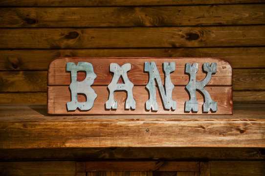 Old Bank sign on side of a building