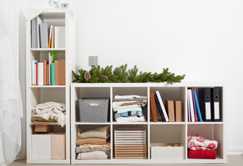 white room interior with christmas decoration, rack with items