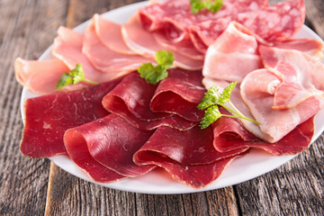 assorted of salami and bacon