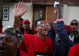 Members of the ultra-left Economic Freedom Fighters sing outside the Constitutional Court in Johannesburg