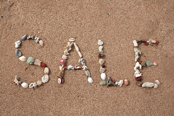 Text Sale made from shell on sandy beach. Background for ad or web design