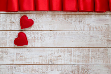 Valentines Day background with hearts over white wooden table