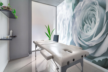 View of an Interior of a modern clean massage room.
