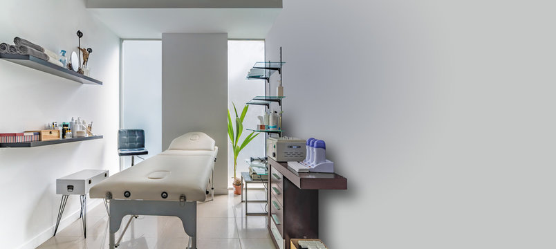 Panoramic view of an Interior of a modern clean massage room. Copy space