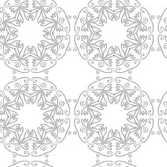 Seamless vintage decorative pattern with a black circular geometric pattern on a white background. Hand drawing.