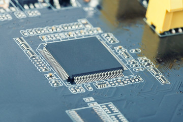 Electronic manufacturing and repair concept - close up studio shot of microcircuit