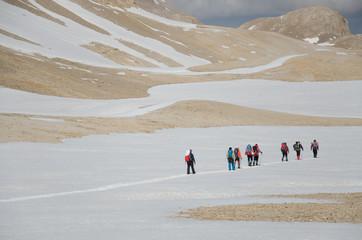 Group of hikers in snowy mountains. Turkey, Central Taurus Mountains, Aladaglar (Anti Taurus).