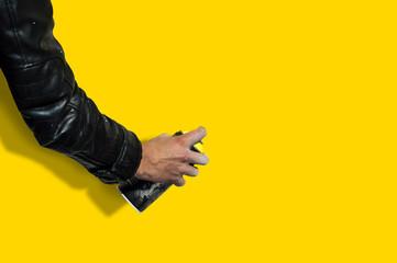 Human hands holding a graffiti Spray can