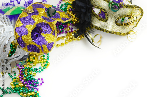Mardi Gras border or frame of carnival masks, beads, ribbons and ...