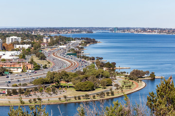 The Kwinana Freeway at Mill Point Road in Perth, Western Australia winds it's way along the Swan River heading south towards Mandurah.