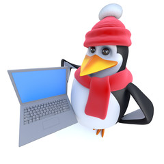 3d Funny cartoon penguin dressed for winter and holding a laptop pc