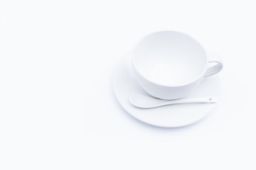 Empty white cup coffee and a spoon on white background,top view
