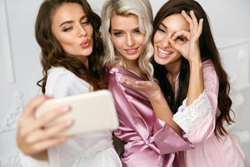 Beautiful Women Making Photos On Phone