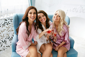 Girls Party. Beautiful Women Friends In Robes Having Fun