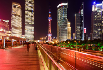 Shanghai Night - With its glittering modern skyscrapers and, bright and colorful streets, Lujiazui has became a popular night time tourist attraction in Shanghai, China.