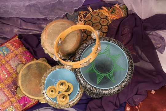 Top view of musical instruments of a bellydance percussiongroup with darbuka's, tambourines and zills