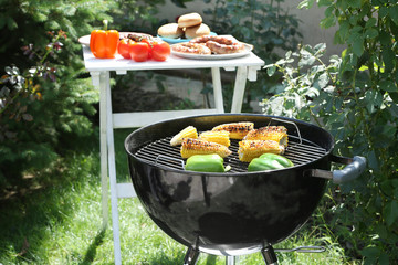 Barbecue grill with tasty vegetables on backyard