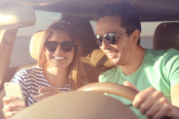 Beautiful young couple in car